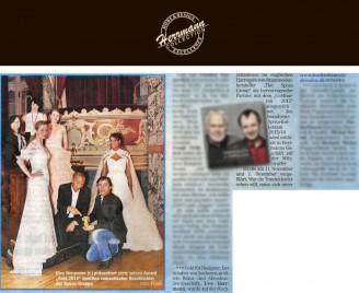 Uwe Herrmann präsentiert stolz seinen Award Gold 2012 inmitten romantischer Brautkleider der Sposa-Gruppe - Hochzeitsmode Dresden - Uwe Herrmann